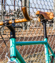 Carrea fixed gear by a sunny fence